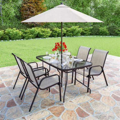 brown metal and 6 seater garden dining set parasol