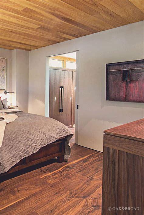 stunning contemporary home  wide plank black walnut floor