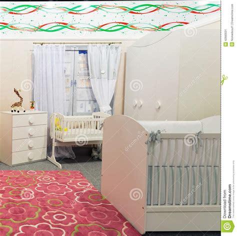 slaapkamer l baby de slaapkamer van de baby in pastelkleuren stock
