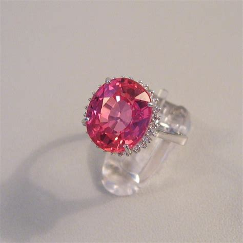 ring with orange pink padparadscha sapphire and 27 white sapphires catawiki