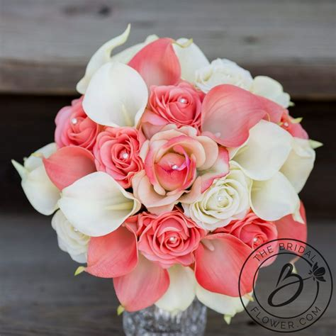 coral  ivory wedding bouquet roses  calla lilies