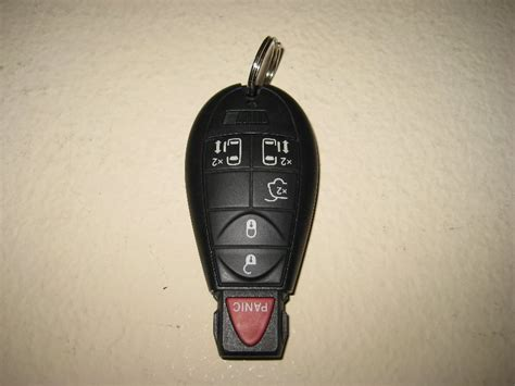 You should be able to open your trunk lid with the blade key, insert it and turn it then 'push up' on the release button and no sync is required as i changed my battery in my fob and worked like a charm. Chrysler Key Fob Battery - Supercars Gallery
