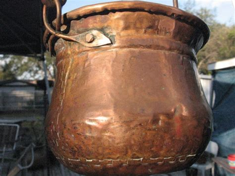 antique primitive hammered hanging copper cast iron cooking pot dovetail seams copper pots display