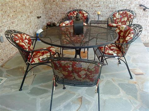 complimenting patio with wrought iron patio furniture