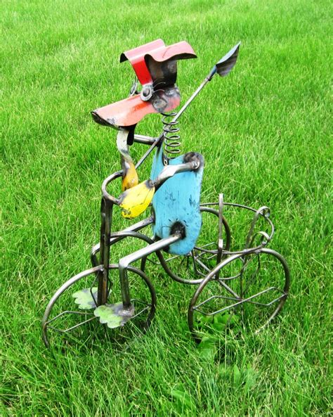 recycled metal dog on tricycle metal lawn ornament