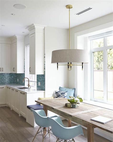white kitchen  blue fish scale backsplash tiles