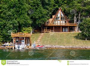 stunning images frame of house a frame house on water with boats royalty free stock photo
