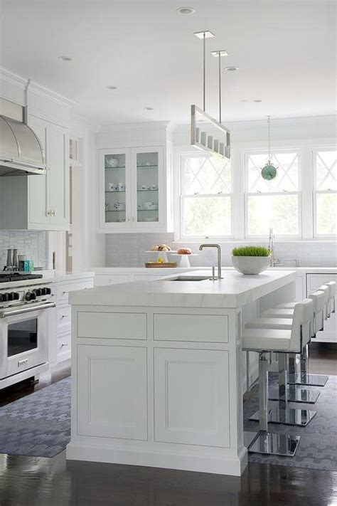 white kitchen island  thick marble countertop