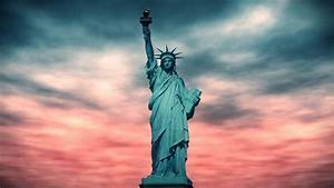 Statue, Of, Liberty, Against, A, Dramatic, Red, Sky, Background