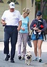 Anna Faris makes working out a family affair as she totes ...