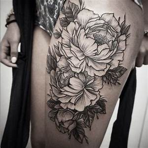 Rough-sided black-and-white flower tattoo on thigh ...