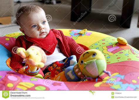 Baby Playing With Soft Toy In Playpen Stock Image Image