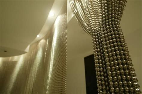 a modern bead curtain shimmer screen apartment therapy