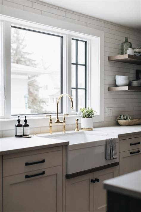 Cabinet hardware is like jewelry of a kitchen — it changes the look and feel of your cabinetry depending on the kind of cabinet it's paired with. White shaker cabinets accented with oil rubbed bronze ...