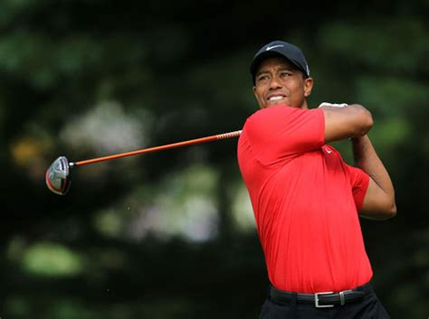 Swiss watchmaker Tag Heuer drops Tiger Woods; contract was ...