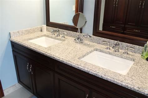 bathroom countertops with sinks built in blue bathroom with pearl granite countertops and two