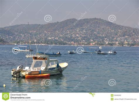 Fishing Boats In Zihuatanejo by Zihuatanejo Boats At Sunset Stock Photography