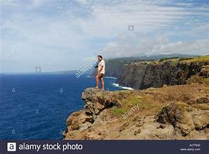 Tourist Standing On Precipice On High Sea Cliffs Of ...