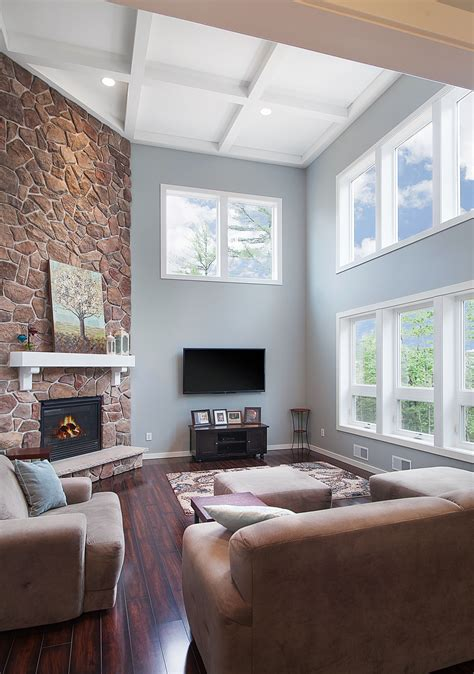 story open great room   coffered ceiling stone