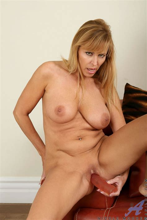 Mature Blonde Enjoys Toying On Red Couch Porn Tv