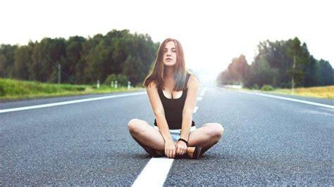 women sitting legs crossed   viewer road