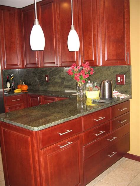 granite countertops with cherry cabinets kitchen