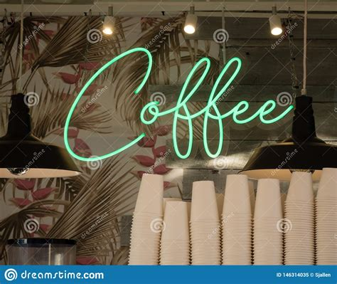 We've gathered more than 5 million images uploaded by our users and sorted them by the most popular ones. Green Neon Sign With Text Coffee On Wallpaper And Boards Behind Stacked Paper Cups Stock Image ...