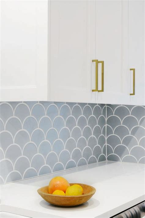 carrera marble fan shaped fish scale tile backsplash modern kitchen
