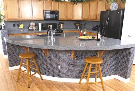 granite kitchen coutertops with mosaic backsplash