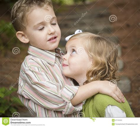 Adorable Brother And Sister Children Hugging Outside Stock