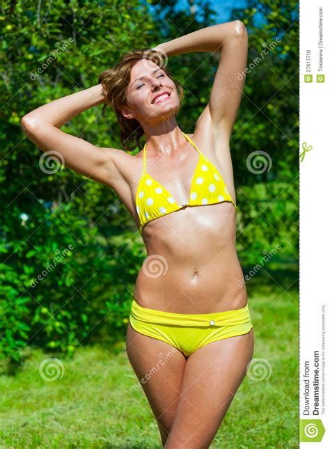 The Young Girl In A Bathing Suit Sunbathes Stock Photo