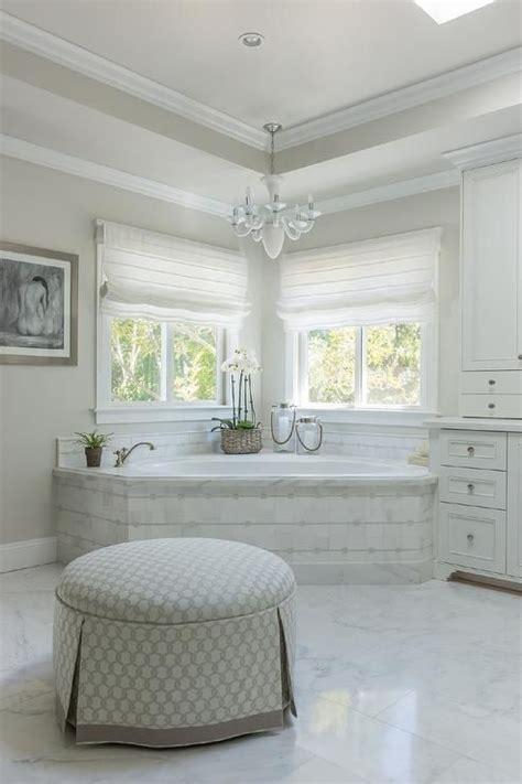 corner marble tiled tub  windows transitional