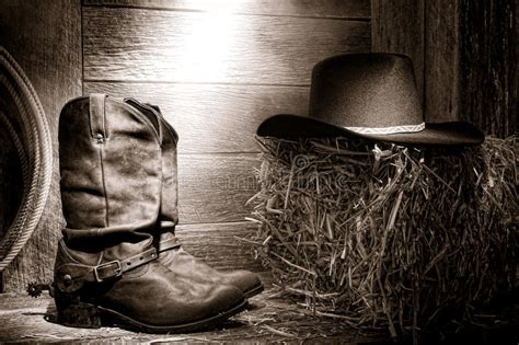American West Rodeo Cowboy Boots And Hat In Barn Stock