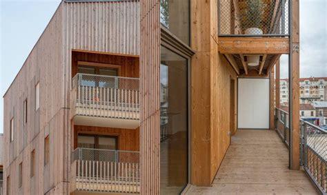 prefab parisian housing  clad   double skin timber