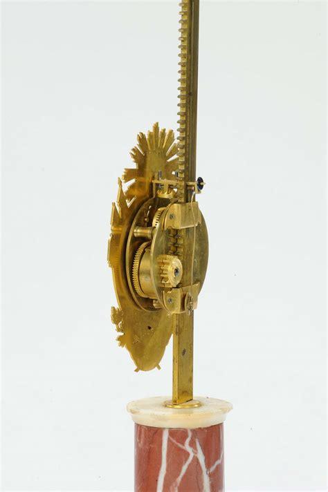 asta a cremagliera orologio luigi xvi a cremagliera in bronzo dorato con base