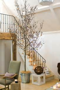 how to decorate with trees twigs logs and branches furnish burnish