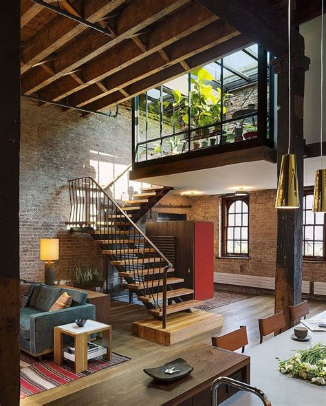 An 1884 Former Caviar Warehouse Loft In Tribeca by Beautiful Staircase Connects The Living Area With The