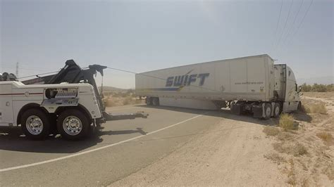 video tow truck rescues stuck in sand