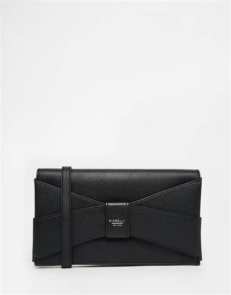 lyst fiorelli small clutch bag  black