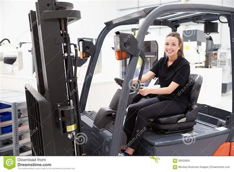 Portrait Of Female Fork Lift Truck Driver In Factory Stock