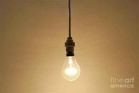 bare hanging light bulb by sami sarkis