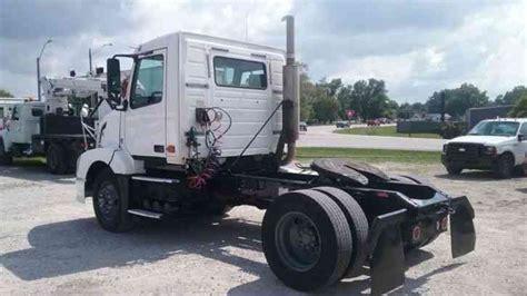 volvo vnmt road tractor  daycab semi trucks