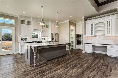 White Cabinets Gray Countertops by Gray Island With Turned Legs Transitional Kitchen