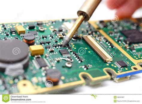 Electrical Engineer Soldering Printed Circuit Board