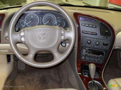 2003 Oldsmobile Aurora 4.0 Neutral/Dark Neutral Dashboard ...