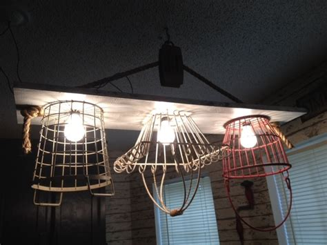 made rope pulley and wire basket light fixture