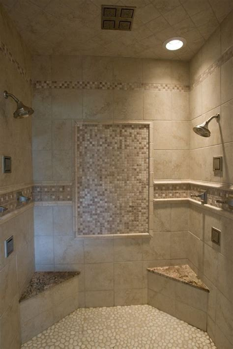 walk in shower with seat walk in tile shower with tile accents a pebble floor two corner seats with granite on top a