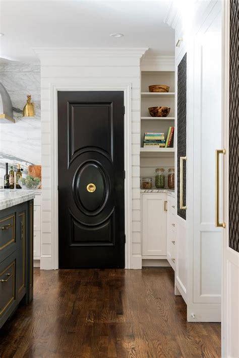 glossy black pantry door  brass door knob