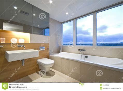 modern en suite bathroom  large window stock photo
