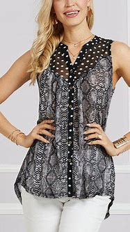 channel your wild side in this snake print top designed ...